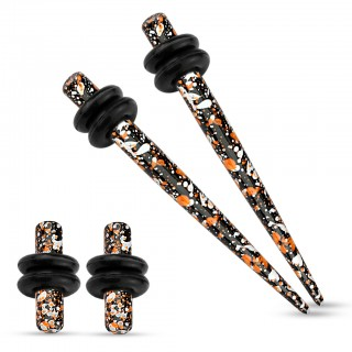 Ear stretching set inc. orange and black paint splash plugs