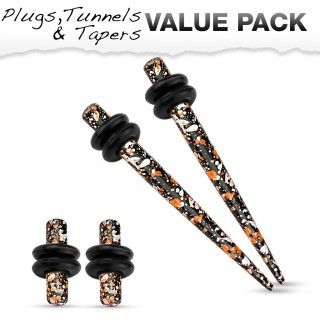 Ear stretch kit inc. stretch plugs with orange black splatter pattern